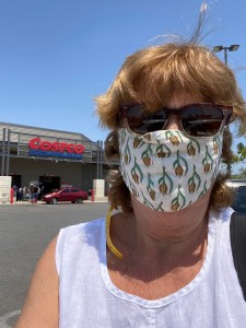 Jen with her mask in front of Costco in Merida
